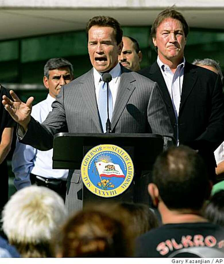 Gov. Arnold Schwarzenegger talks to the crowd at a budget rally as Mayor Alan Autry looks on Wednesday, Sept. 17, 2008 in Fresno, Calif. The state's political dysfunction reached a new low this week with Gov. Arnold Schwarzenegger vowing the first veto of a California budget in modern history. The spat goes beyond the numbers; it's about what may be the governor's last chance to hammer out a fiscal legacy. (AP Photo/Gary Kazanjian) Photo: Gary Kazanjian, AP