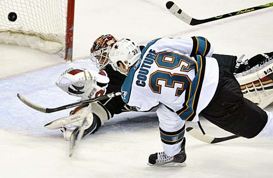 San Jose Sharks center Logan Couture (39) slaps the puck past Niklas Backstrom, left, of Finland, during the third period of an NHL hockey game Friday, April, 2, 2010, in St. Paul, MInn. San Jose won 3-2. Photo: Tom Olmscheid, AP