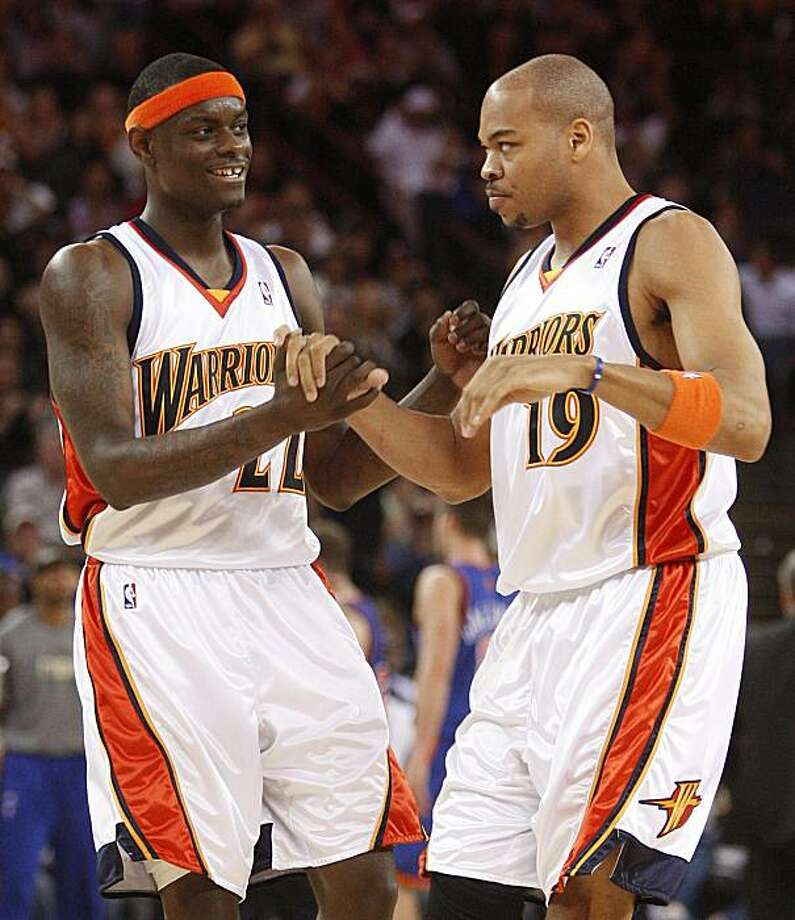 Golden State Warriors' Anthony Morrow, left, and Devean George celebrate during a timeout in the fourth quarter of an NBA basketball game against the New York Knicks Saturday, April 2, 2010, in Oakland, Calif. Photo: Ben Margot, AP
