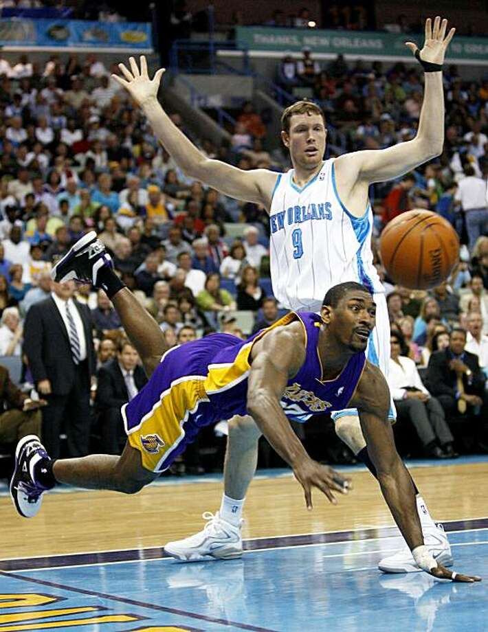Los Angeles Lakers forward Ron Artest (37) loses the ball as he tries to move past New Orleans Hornets forward Darius Songaila (9) during the second half of an NBA basketball game in New Orleans, Monday, March 29, 2010. The Hornets won 108-100. Photo: Sean Gardner, AP