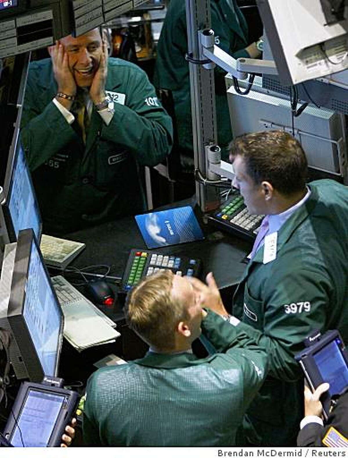 Traders react on the floor just after the closing bell at the New York Stock Exchange, September 18, 2008. Wall Street had its best day in six years on Thursday as a furious rally late in the day was sparked by news that the government is considering a more comprehensive solution to the financial crisis than the current piecemeal approach. REUTERS/Brendan McDermid (UNITED STATES)