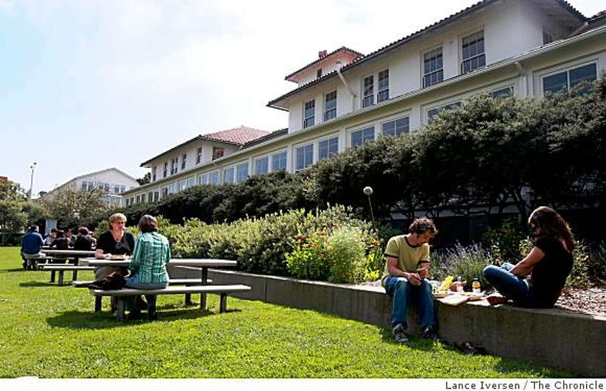 """Employees and guest of many of the non-profits that call the old Letterman Hospital their new business address enjoy the grounds to the rear of the main building. The Thoreau Center for Sustainability at the Presidio, run by the Tides Foundation, has provided a stable """"home"""" and millions of dollars in rent savings for 70 nonprofits. Photographed in San Francisco Sept 11, 2008"""