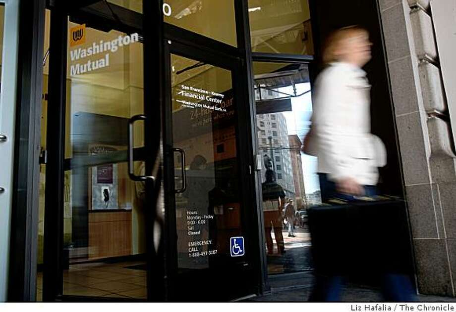 People walk out of the Washington Mutual bank on Market at Third Streets in San Francisco, Calif., on Wednesday, September 9, 2008. Photo: Liz Hafalia, The Chronicle