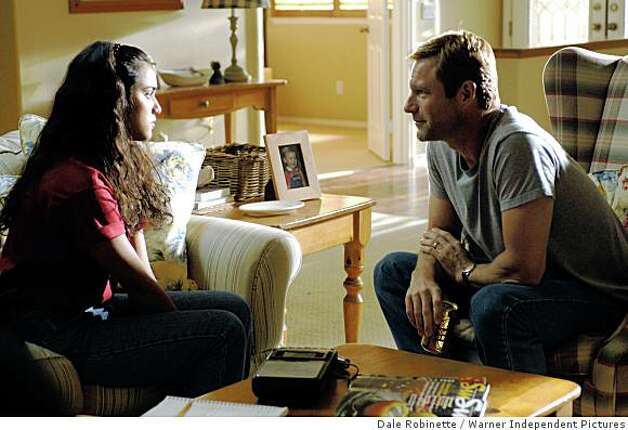 "Summer Bishil and Aaron Eckhart in Alan Ball's ""Towelhead."" Photo: Dale Robinette, Warner Independent Pictures"