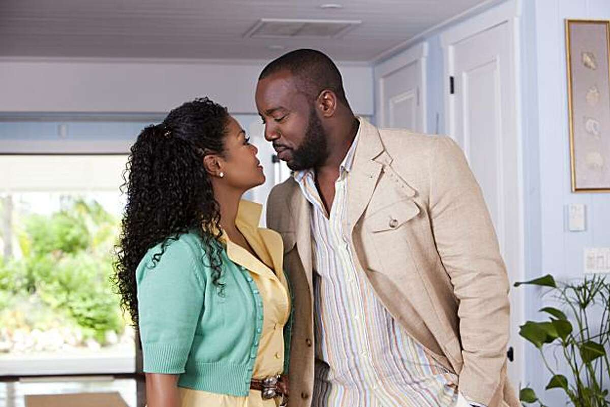 """In this film publicity image released by Lionsgate, Janet Jackson, left, and Malik Yoba are shown in a scene from, """"Tyler Perry's Why Did I Get Married."""""""