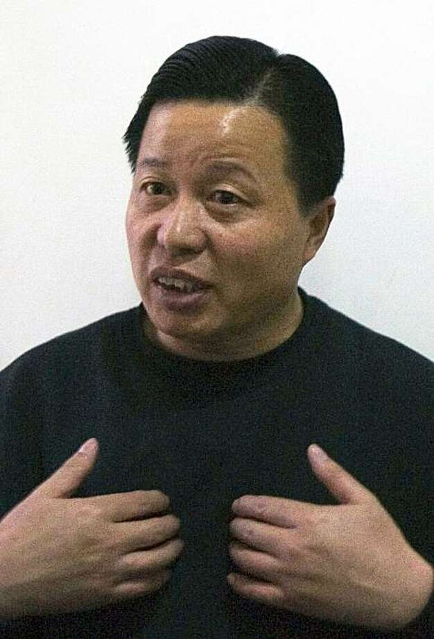 FILE - In this Feb. 24, 2006 file photo, Gao Zhisheng,  one of China's most daring lawyers,  gestures during an interview at a tea house in Beijing, China. Gao, a dissident Chinese lawyer who was missing for more than a year says he is now living in northern China and wants only to spend time with his family away from media attention. Photo: Ng Han Guan, AP