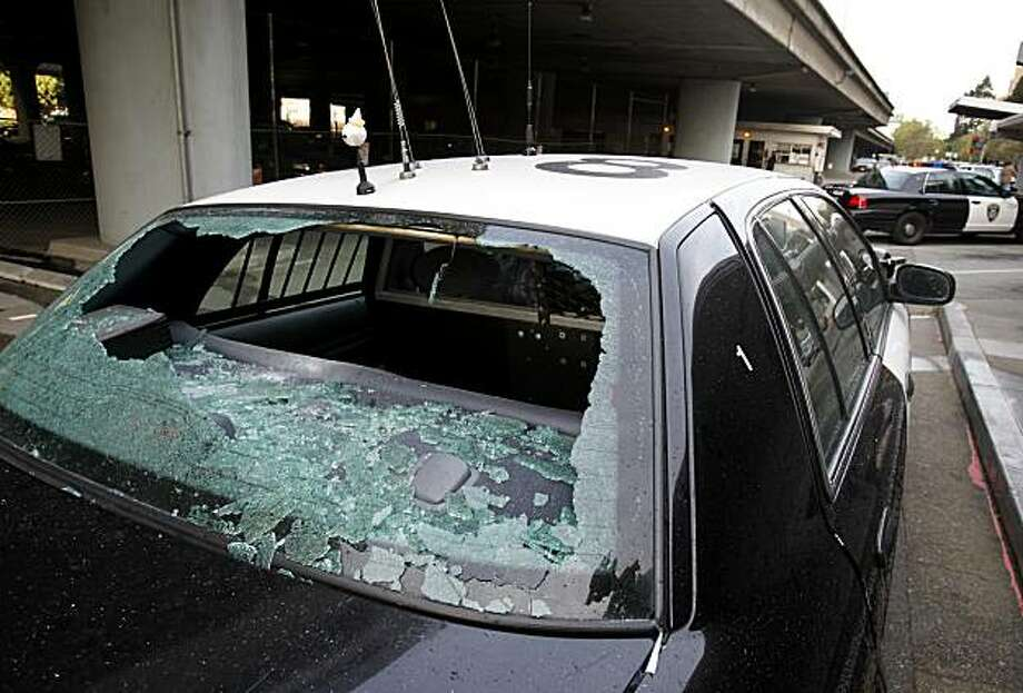 One of about a half dozen Oakland police cars vandalized Saturday night by a person who was then shot by Oakland police. Photo: Brant Ward, The Chronicle