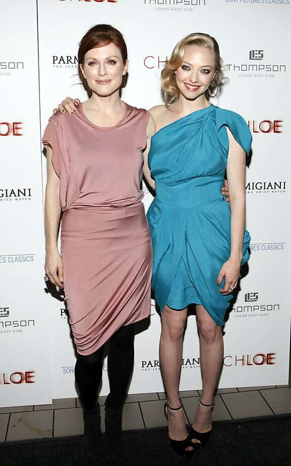 "Julianna Moore, left, and Amanda Seyfried arrive to the New York premiere of the film ""Chloe"" on Monday, March 15, 2010. Photo: Stuart Ramson, AP"