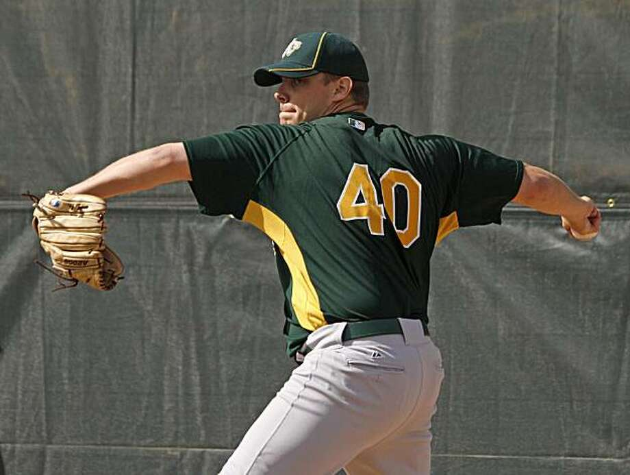 Oakland Athletics pitcher Andrew Bailey throws during spring training baseball in Phoenix, Wednesday, Feb. 24, 2010. Photo: Eric Risberg, AP