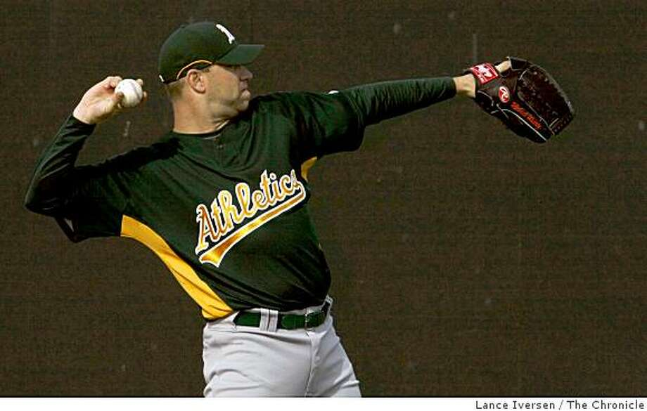 Oakland Athletics pitcher Michael Wuertz warms up during Spring Training workouts at the Papago Baseball Facility Monday February 16, 2009 in Phoenix Arizona Photo: Lance Iversen, The Chronicle