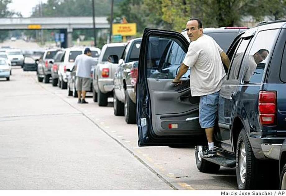 A motorist looks out of his car while lined up to get gas at one of the few open stations in Houston, Texas, Sunday, Sept. 14, 2008.(AP Photo/Marcio Jose Sanchez) Photo: Marcio Jose Sanchez, AP