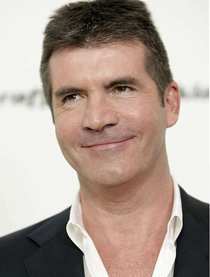 FILE - In this Sunday, Feb. 22, 2009 file photo, Simon Cowell poses on the press line at the Elton John Academy Award viewing and after party in West Hollywood, Calif. Photo: Dan Steinberg, File, AP