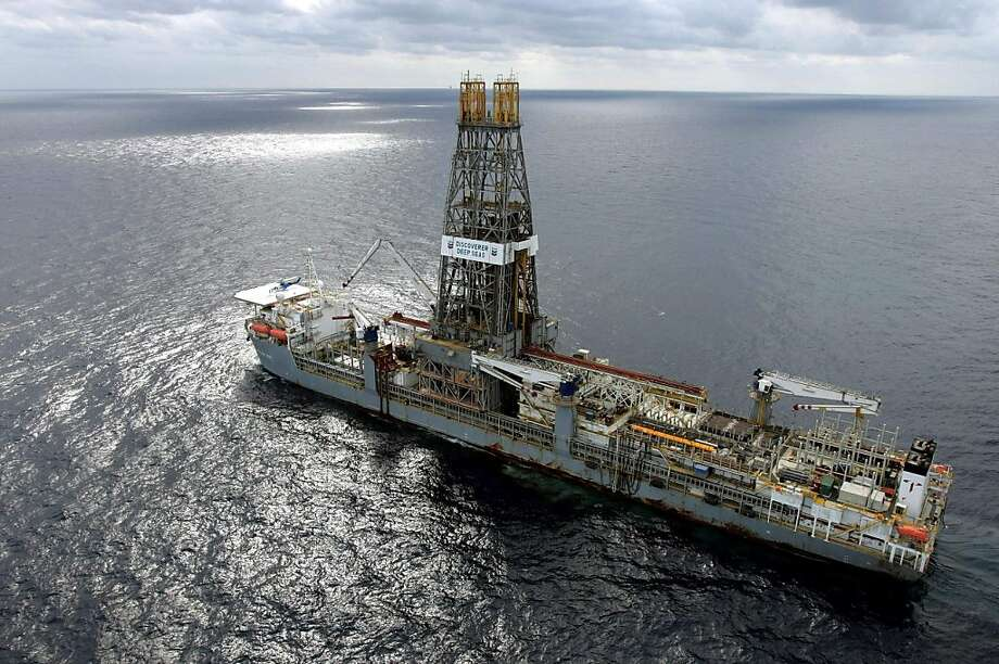 ** FILE ** In this March 28, 2006 file photo, the Discoverer Deep Seas drillship sits on station off the coast of Louisiana as Chevron drills for oil in the Gulf of Mexico.  As the House and Senate reconvene Monday after back-to-back political conventions, both parties eager to use the three-week session to show voters why their candidates are the ones to fix the economy and lower energy prices.  Republicans have made the Democrats' reluctance to open up more offshore areas to oil drilling the major theme in their effort to minimize the anticipated loss of GOP House and Senate seats in November.  (AP Photo/Alex Brandon, File) Photo: Alex Brandon, AP