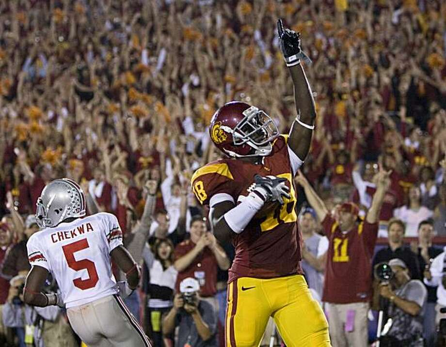 Southern California wide receiver Damian Williams 918) celebrates in the end zone after catching touchdown pass against Ohio State during the third quarter ofan NCAA college football game in Los Angeles, Calif., Saturday, Sept. 13, 2008. USC won 35-3. (AP Photo/Mark Avery) Photo: Mark Avery, AP