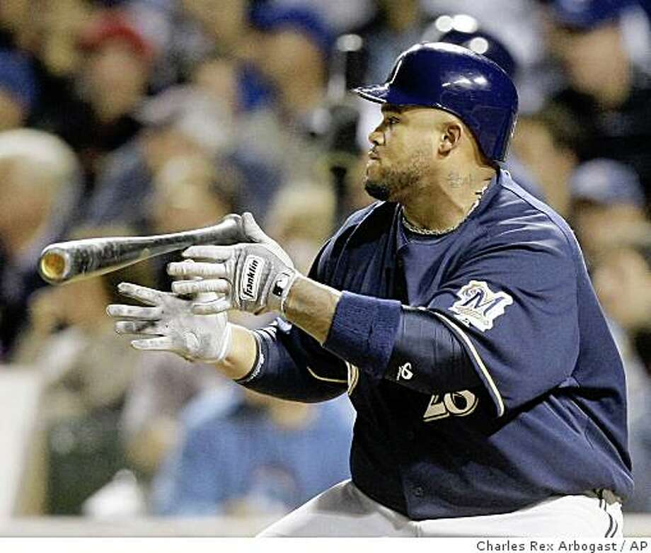 Milwaukee Brewers' Prince Fielder releases the bat as his three-run double heads to deep right field during the first inning of a baseball game against the Chicago Cubs at Wrigley Field in Chicago, Wednesday, Sept. 17, 2008. (AP Photo/Charles Rex Arbogast) Photo: Charles Rex Arbogast, AP