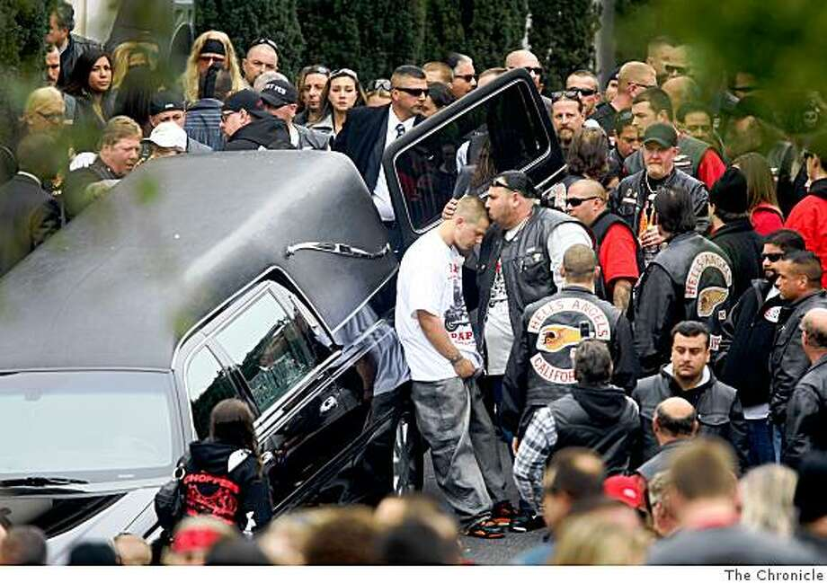 Mourners console each other after the funeral for slain president of the San Francisco chapter of the Hells Angels Mark Guardado at Duggan�s Serra Mortuary on Monday, September 15, 2008 in Daly City, Calif. Photo: The Chronicle