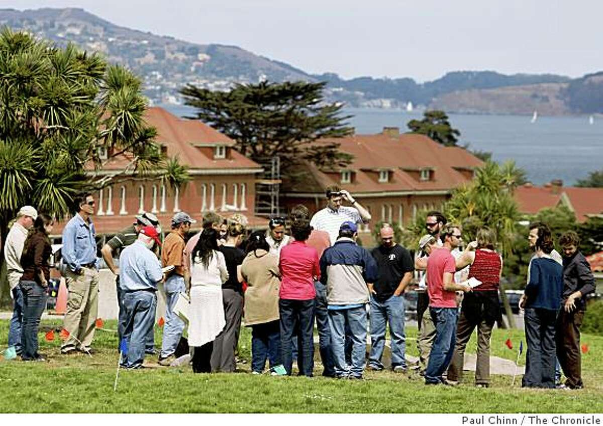 Archeologists gather around an excavation site during a week-long project at the Main Post of the Presidio in San Francisco, Calif., on Friday, Sept. 19, 2008.