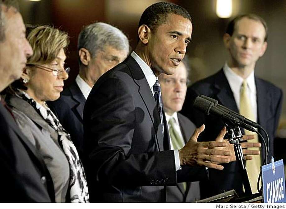 CORAL GABLES, FL - SEPTEMBER 19:  Democratic U.S. Presidential nominee Sen. Barack Obama (D-IL) (3rd-L) speaks at a press conference before a campaign rally at the Bank United Center on the campus of the University of Miami on September 19, 2008 in Coral Gables, Florida. Prior to speaking with the media Obama met with several economic advisors to discuss the nation's current financial crisis.  (Photo by Marc Serota/Getty Images) Photo: Getty Images