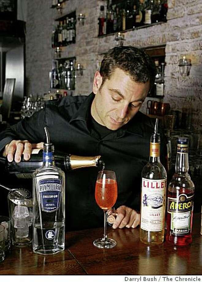 "Bartender Jon Santer makes  ""The Pearl"" at Bourbon & Branch in San Francisco. Photo: Darryl Bush, The Chronicle"