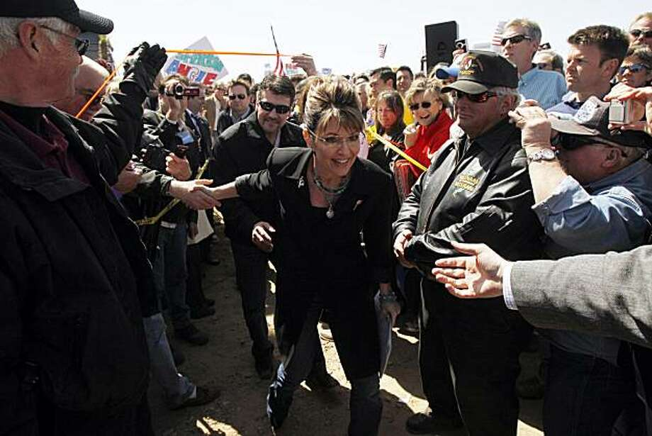 "Sarah Palin, center, and her husband Todd arrive to speak at the ""Showdown in Searchlight"" tea party rally in Searchlight, Nev., Saturday, March 27, 2010. Photo: Jae C. Hong, AP"