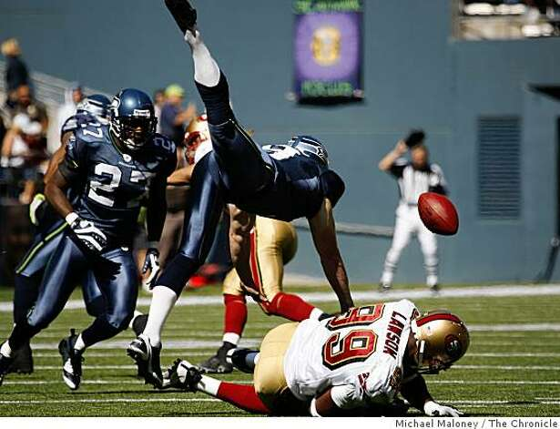 San Francisco 49ers Manny Lawson (99) blocks a punt by Seattle's Jon Ryan (top) in the 1st half. The ball was recovered by the Seahawks.The Seattle Seahawks host the San Francisco 49ers in a NFL game at Qwest Field in Seattle, Wash., on Sept. 14, 2008. Photo: Michael Maloney, The Chronicle