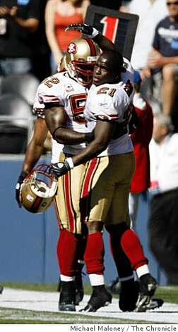 San Francisco 49ers Frank Gore (21) congratulates Patrick Willis (52) after his touchdown in the 3rd quarter.The Seattle Seahawks host the San Francisco 49ers in a NFL game at Qwest Field in Seattle, Wash., on Sept. 14, 2008. The 49ers won 33-30 in overtime. Photo: Michael Maloney, The Chronicle