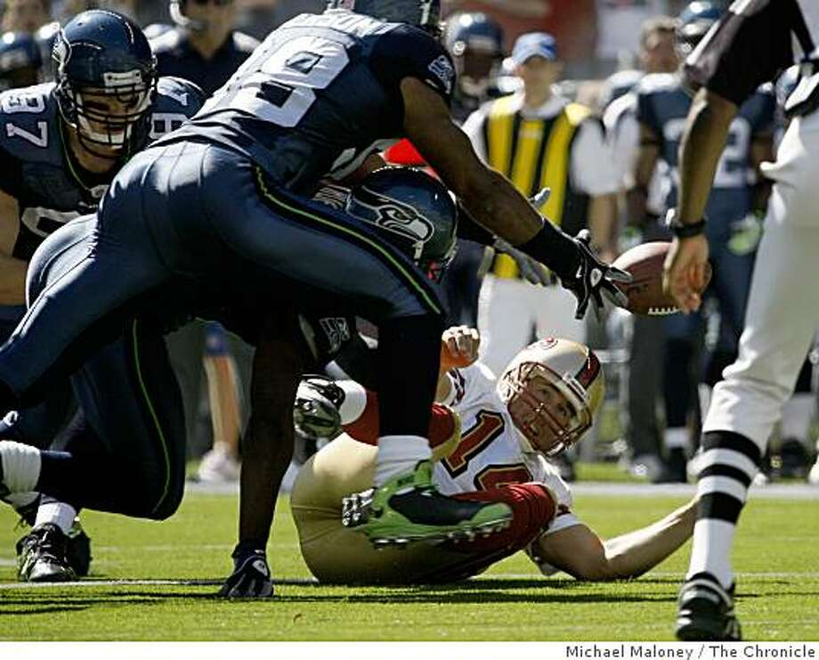 San Francisco 49ers quarterback J.T. O'Sullivan (14) is upended in a scramble for a Frank Gore fumble in the 1st half. Seattle recovered.The Seattle Seahawks host the San Francisco 49ers in a NFL game at Qwest Field in Seattle, Wash., on Sept. 14, 2008. Photo: Michael Maloney, The Chronicle