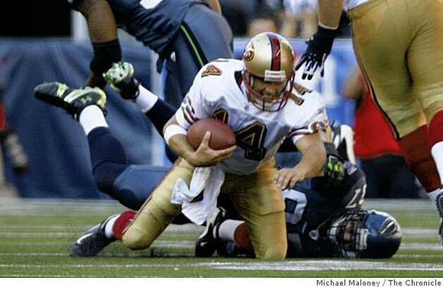 San Francisco 49ers quarterback J.T. O'Sullivan (14) is sacked in the 4th quarter by Seattle Seahawks Patrick Kerney (97).The Seattle Seahawks host the San Francisco 49ers in a NFL game at Qwest Field in Seattle, Wash., on Sept. 14, 2008. The 49ers won 33-30 in overtime. Photo: Michael Maloney, The Chronicle