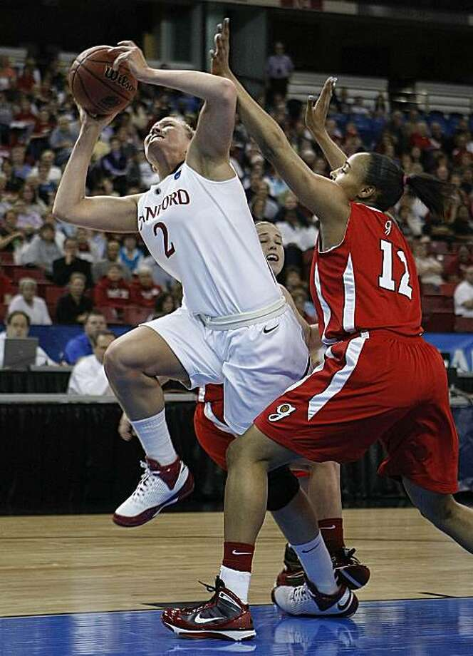 Stanford's Jayne Appel gets inside Georgia's Meredith Mitchell as Stanford plays Georgia in the regional semifinals of the 2010 NCAA Women's Basketball Tournament at Arco Arena in Sacramento on Saturday. Photo: Michael Macor, The Chronicle
