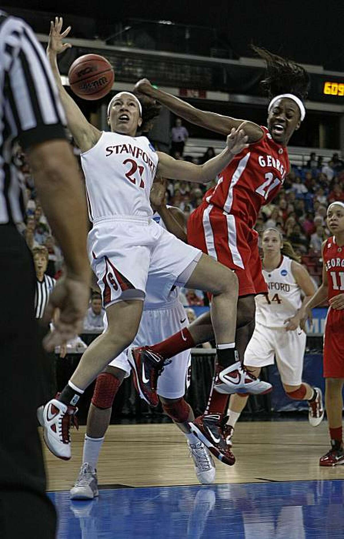 Rosalyn Gold-Onwude battles Porsha Phillips in the first half, as Stanford takes on Georgia in the regional semifinals of the 2010 NCAA Women's Basketball Tournament at Arco Arena in Sacramento on Saturday.
