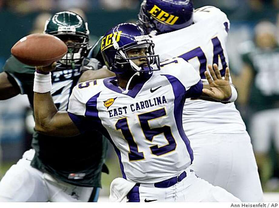 East Carolina quarterback Patrick Pinkney (15) throws a pass during the fourth quarter of an NCAA college football game against Tulane in New Orleans, Saturday, Sept. 13, 2008. East Carolina beat Tulane 28-24. (AP Photo/Ann Heisenfelt) Photo: Ann Heisenfelt, AP