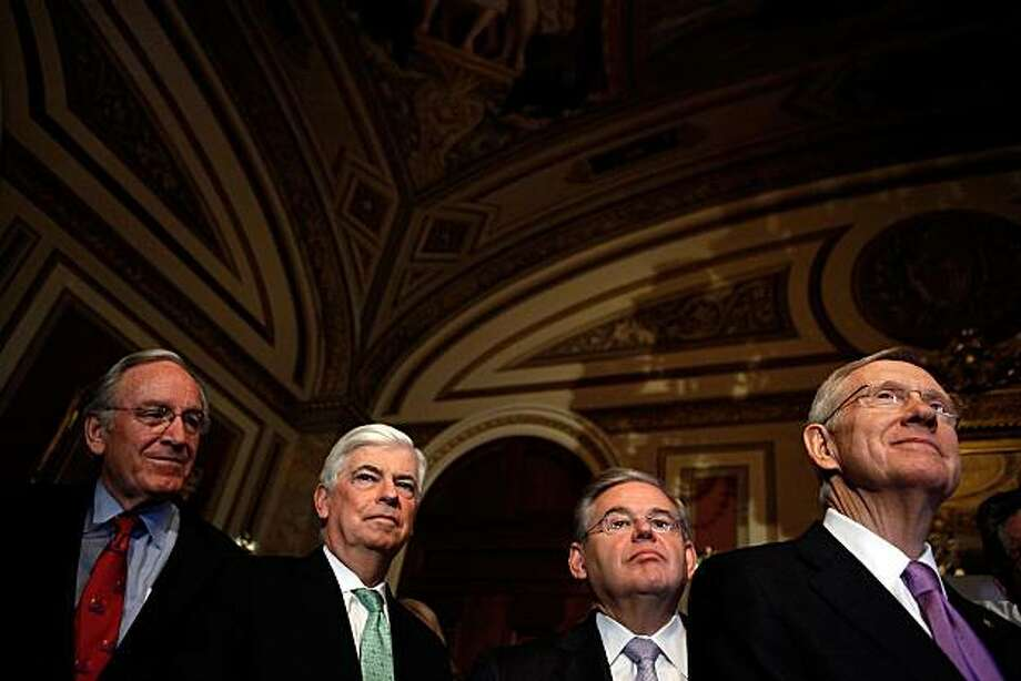 WASHINGTON - MARCH 24:  (L-R) Sen. Tom Harkin (D-IA), Sen. Christopher Dodd (D-CT), Sen. Robert Menendez (D-NJ) and Senate Majority Leader Harry Reid (D-NV) hold a news conference about the benefits to seniors in the new health care reform law at the U.S.Capitol March 24, 2010 in Washington, DC. The lawmakers rallied with members of the Association of American Retired Persons (AARP) and physicians groups to talk about how the new legislation will close the 'donut hole' and make prescription drugs more affordable for seniors. Photo: Chip Somodevilla, Getty Images
