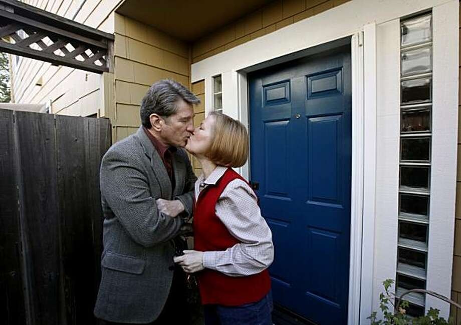 Rick MacKinzie kisses his wife Francine, as she leaves for her job as an elementary school secretary, at their home in Napa, Calif., on Friday, March 26, 2010. The couple have had trouble making their mortgage payments after Rick MacKinzie lost his job several months ago and have made numerous attempts to modify their loan. Photo: Paul Chinn, The Chronicle