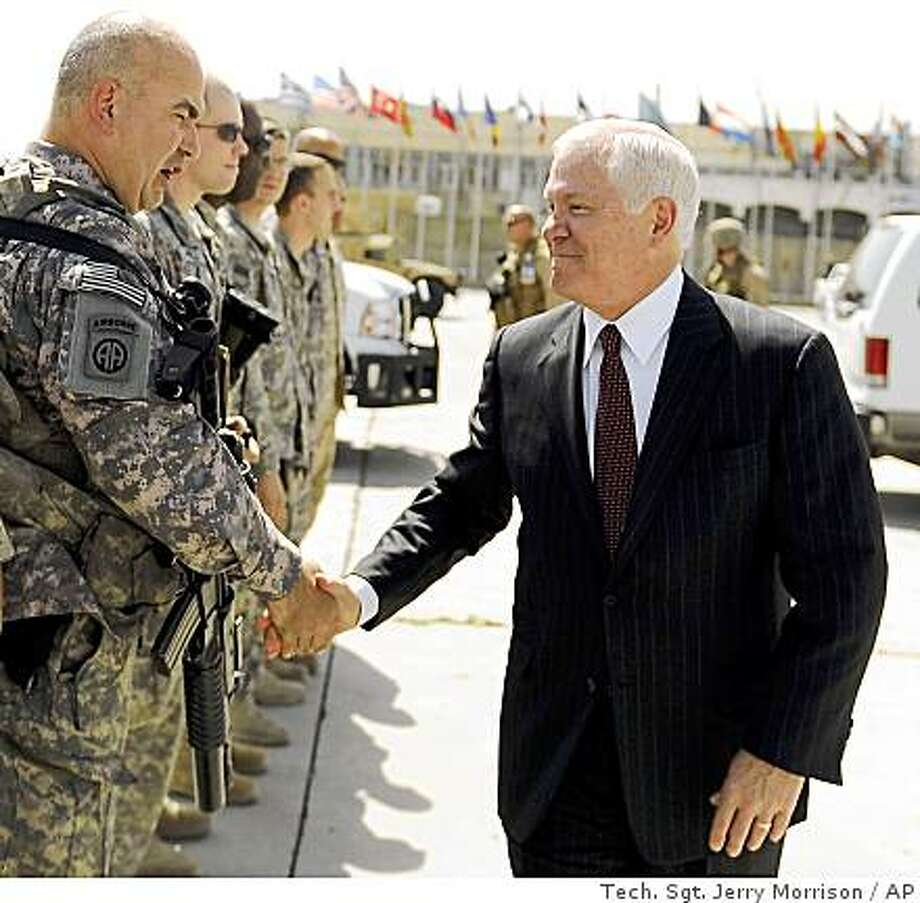 In this photo released by the Defense Department, U.S. Defense Secretary Robert Gates, right, meets with troops at Kabul International Airport, Afghanistan, Wednesday Sept. 17, 2008. (AP Photo/ Defense Dept., Tech. Sgt. Jerry Morrison) Photo: Tech. Sgt. Jerry Morrison, AP