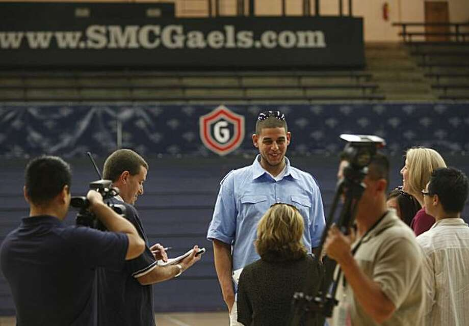 Omar Samhan, St Mary's Men's Basketball center, towers over members of the media during a press conference at McKeon Pavillion on Monday March 22, 2010 in Moraga, Calif.  The St Mary's Gaels have advanced to the third-round NCAA Tournament game. Photo: Mike Kepka, The Chronicle