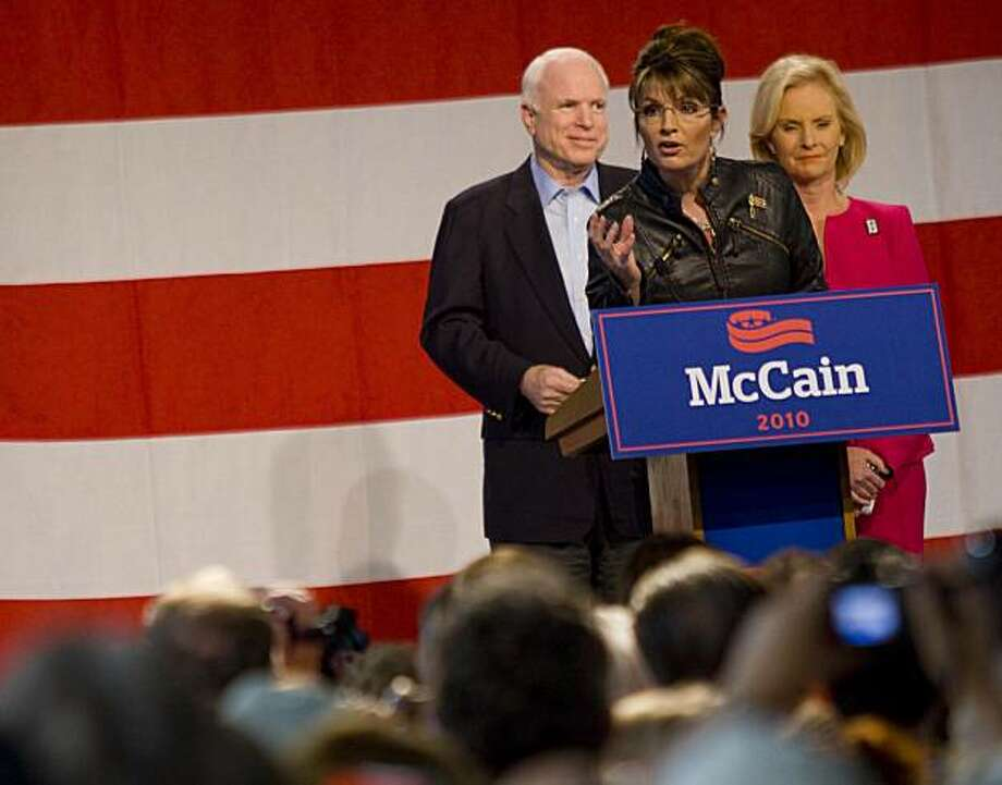 TUCSON, AZ - MARCH 26:  Former Alaska Gov. Sarah Palin (L) speaks as U.S. Sen. John McCain (R-AZ) and his wife Cindy McCain (R) look on during a campaign rally at Pima County Fairgrounds on March 26, 2010 in Tucson, Arizona. Palin traveled to Arizona to stump for McCain, who is facing a primary challenge in his bid for a fifth term in the Senate. Today's event marked the first time the pair had campaigned together since their failed 2008 presidential run. Photo: Darren Hauck, Getty Images