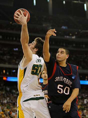 HOUSTON - MARCH 26: Josh Lomers #50 of the Baylor Bears grabs a rebound in front of Omar Samhan #50 of the St. Mary's Gaels during the south regional semifinal of the 2010 NCAA men's basketball tournament at Reliant Stadium on March 26, 2010 in Houston, Texas. Photo: Jonathan Daniel, Getty Images