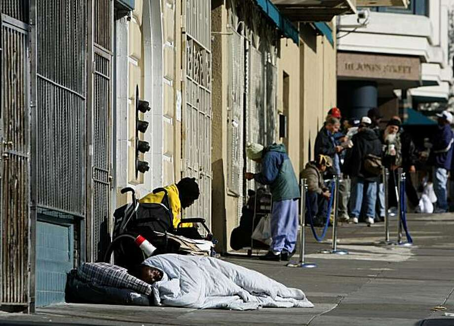 Homeless men gather on a Jones Street sidewalk near Market Street in San Francisco, Calif., on Friday, April 25, 2008. Millions of dollars of redevelopment funds earmarked to spruce up the neighborhood has been tied up in political limbo and may go to waste. Photo by Paul Chinn / San Francisco Chronicle Photo: Paul Chinn, The Chronicle