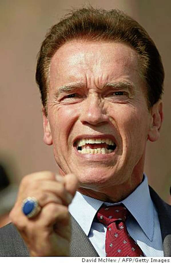 California Gov. Arnold Schwarzenegger attends a press conference with the California Contract Cities Association and the Independent Cities Association in support of his California budget proposal on August 27, 2008 in Los Angeles, California. Schwarzenegger is scheduled to speak at the Republican National Convention but said he may cancel as law makers continue to struggle with a budget deadlock that the governor said could be the longest in state history. California Assembly Speaker Karen Bass had previously planned to not hold sessions for three days, allowing fellow Democrats to participate in the Democratic National Convention, but has decided to continue holding sessions all week. Hundreds of bills await votes as the state budget impasse drags on.   David McNew/Getty Images/AFP  = FOR NEWSPAPERS, INTERNET, TELCOS AND TELEVISION USE ONLY = (Photo credit should read DAVID MCNEW/AFP/Getty Images) Photo: David McNew, AFP/Getty Images