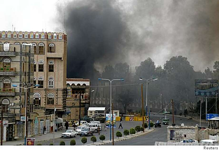 Smoke is seen billowing outside the U.S. embassy in Sanaa September 17, 2008. A car bomb set off a series of explosions outside the heavily fortified embassy in Yemen on Wednesday and a Yemeni security source said at least 16 people, including six attackers, were killed.  REUTERS/Yemen News Agency/Handout (YEMEN).  FOR EDITORIAL USE ONLY. NOT FOR SALE FOR MARKETING OR ADVERTISING CAMPAIGNS. Photo: Reuters