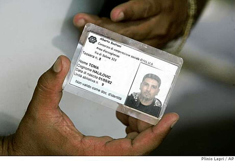 Toma Halilovic shows an unofficial ID card that allows him to enter the Gypsy camp where he lives in Rome, Wednesday, Aug. 6, 2008.  (AP Photo/Plinio Lepri) Photo: Plinio Lepri, AP