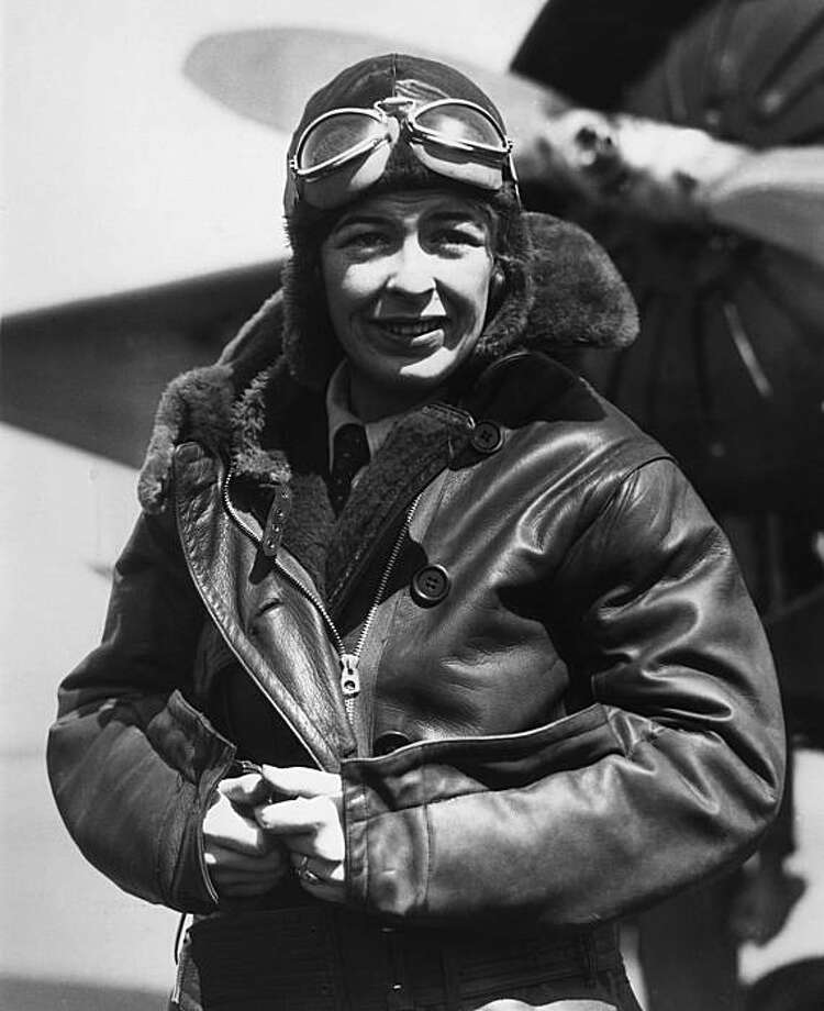 FILE - Elinor Smith stands beside her plane before marking an assault on the women's altitude record at Roosevelt Field, Long Island, in this March 27, 1931 file photo. The family of Elinor Smith says she died Friday March 19, 2010 in a nursing home in Palo Alto. She was 98. Family members say Smith was considered one of the youngest and most daring pilots in the 1920s when she set a number of flying records. Smith became an instant celebrity at the age of 17 when she flew under all four of New York's East River suspension bridges. Photo: AP