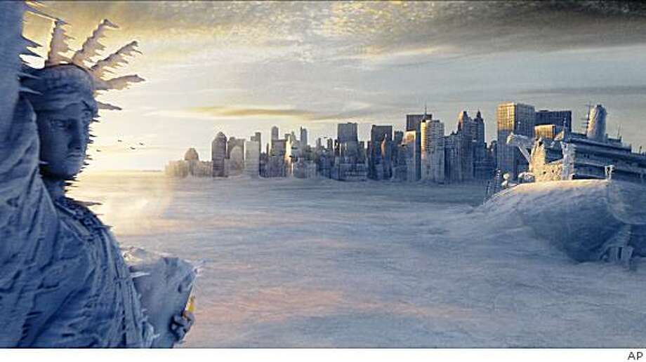 "The Statue of Liberty, left, and the New York city skyline sit in a deep freeze in the wake of a catastrophic climatic shift in a scene from Twentieth Century Fox's ""The Day After Tomorrow,"" in this undated promotional photo. Photo: AP"