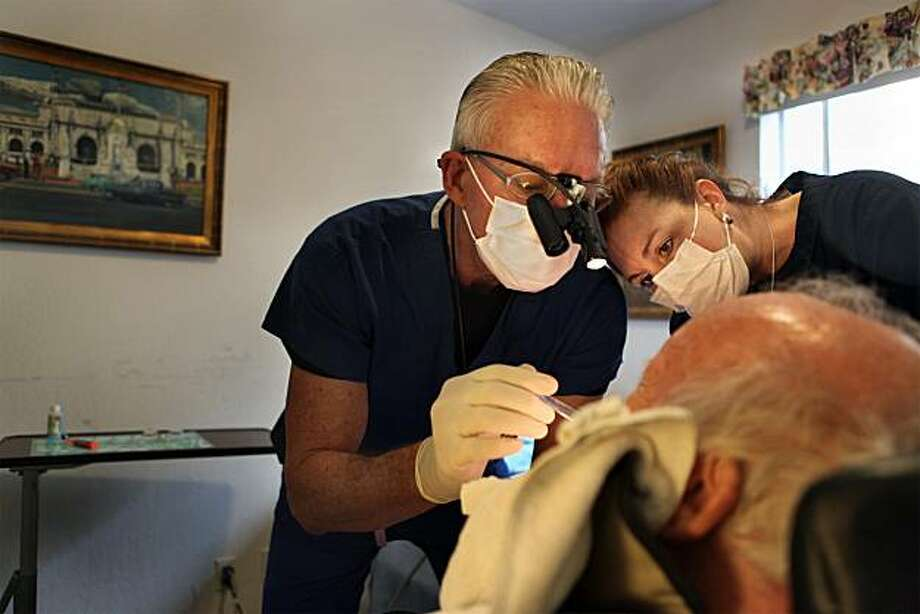 Dr. David Blende and Victoria Cameron, registered dental asistant, doing a check up on a patient in his room at Burlingame Villa on Tuesday, February 23, 2010.  Bay Area House Call Dentists provide in house basic dental care mainly for seniors. Photo: Liz Hafalia, The Chronicle