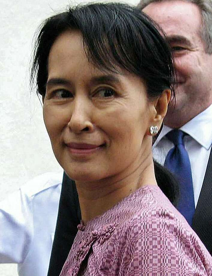 (FILES) A file picture taken on November 4, 2009 shows Myanmar's detained democracy icon Aung San Suu Kyi as she greets a US delegation during a rare public appearance at a hotel in Yangon. Aung San Suu Kyi's Myanmar opposition party has decided to boycott the first elections to be held in the military-ruled country in two decades, a spokesman said on March 29, 2010. Photo: Hla Hla Htay, AFP/Getty Images