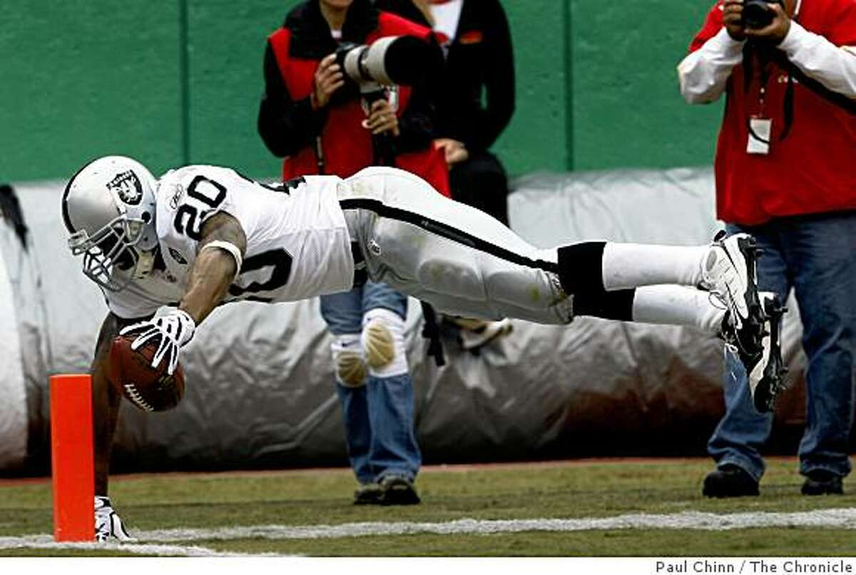 Darren McFadden dives for the end zone to score his first NFL touchdown in the third quarter of the Oakland Raiders vs. Kansas City Chiefs football game at Arrowhead Stadium in Kansas City, Mo., on Sunday, Sept. 14, 2008.