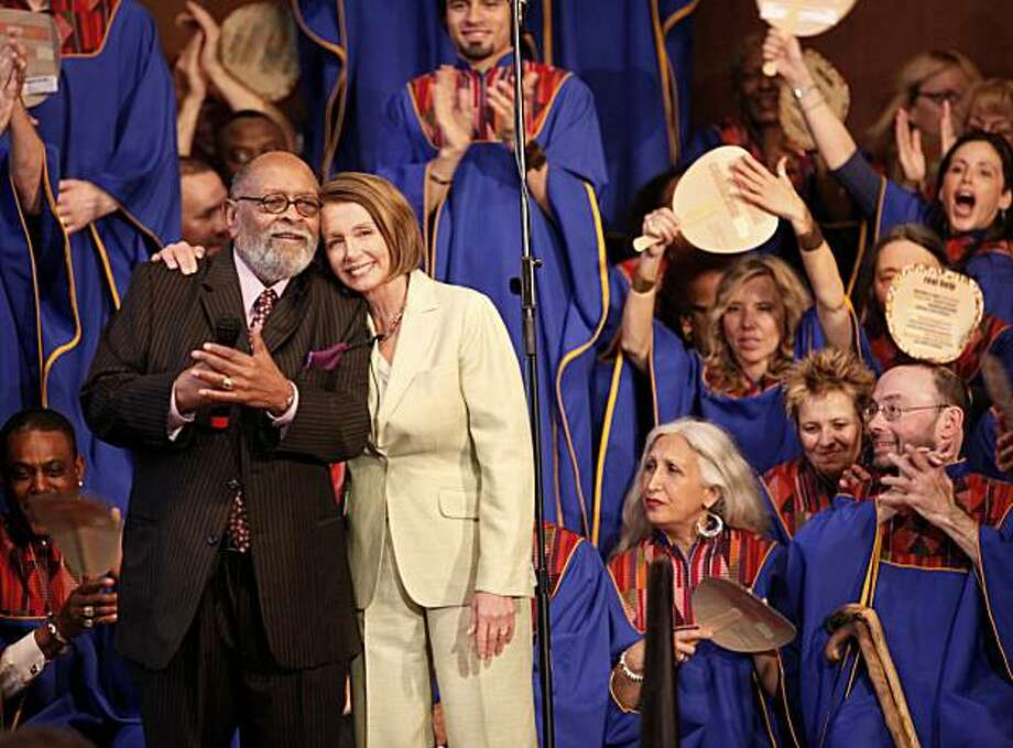 Speaker Nancy Pelosi hugs the Rev. Cecil Williams of Glide Memorial United Methodist Church after he introduced her Sunday. Photo: Brant Ward, The Chronicle