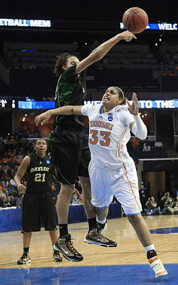 Baylor's Brittney Griner, center, blocks a shot by Tennessee forward Alyssia Brewer (33) in the first half of an NCAA Memphis Regional semifinal college basketball game Saturday, March 27, 2010, in Memphis, Tenn. At left is Baylor guard Kelli Griffin (21). Photo: Lance Murphey, AP