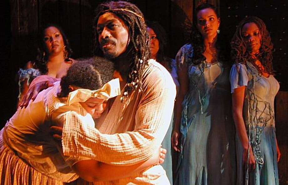 """Erika A. McCrary (left, foreground) seeks comfort from David Westley Skillman in Marcus Gardley's """"...And Jesus Moonwalks the Mississippi"""" Photo: Rob Melrose"""