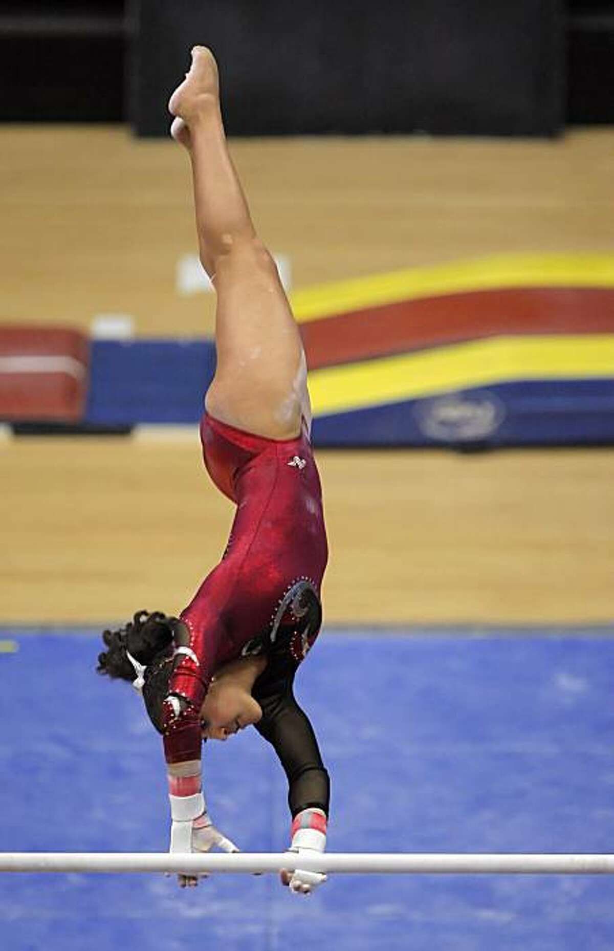 Stanford gymnast Ashley Morgan competes on the parallel bars during a gymnastics competition at Stanford University in Palo Alto, Calif., on Sunday, February 28, 2010. Morgan's father is Baseball Hall of Famer, Joe Morgan.